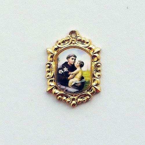 pozlacený medailon sv. Antonín